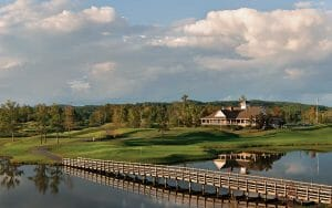 A wooden bridge allows golfers to cross the Heartbreaker eighth hole at Silver Lakes