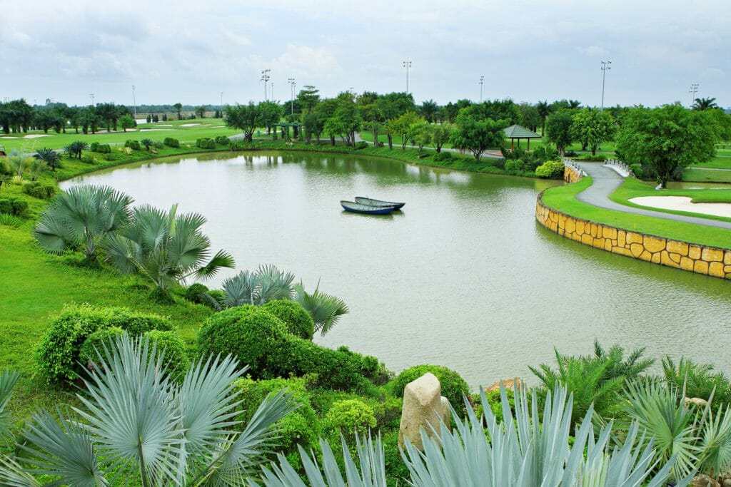 Two canoes float in the middle of a lake at Long Thanh Golf Club in Vietnam