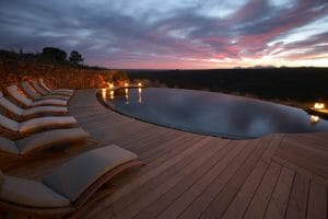 Twilight view of a pool and landscape at Gondwana