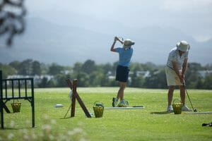 Golfers practice at Fancourt Driving Range