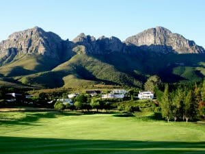 The golf course resides at the base of a mountain