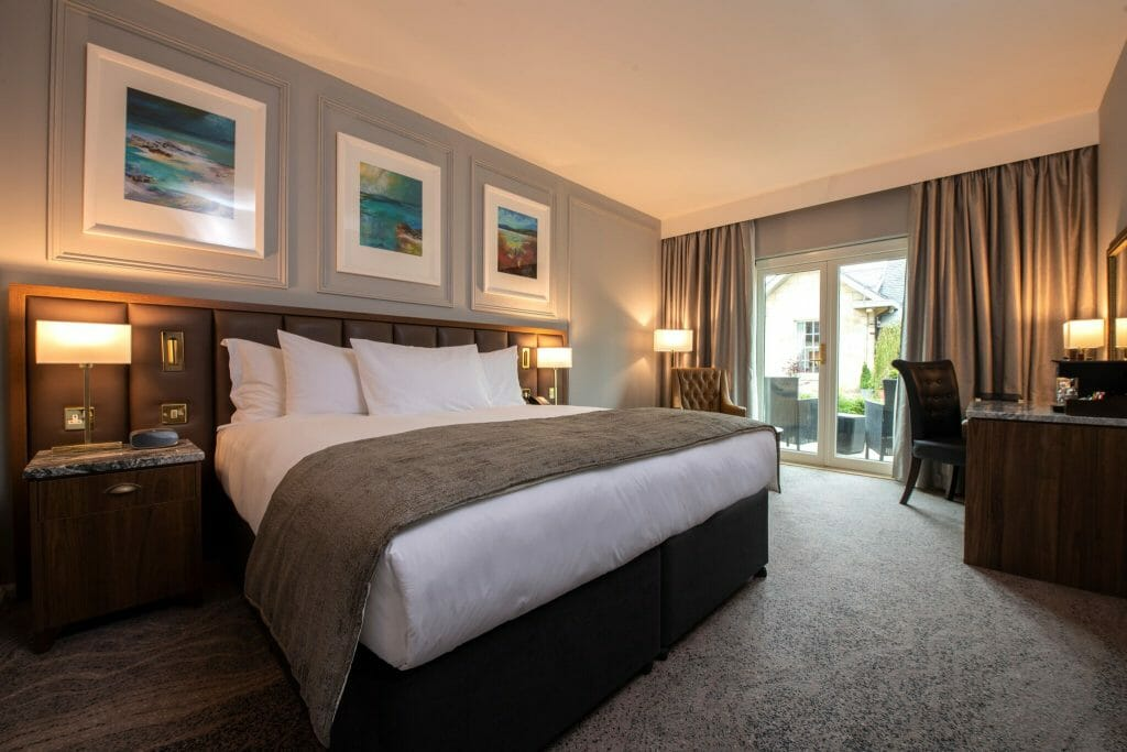 Interior view of a king bed in the Ness Walk Cedar King bedroom