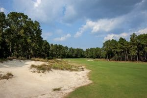 Large sand bunker flanks the second hole