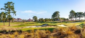 Sand dune golf course and distant Pinehurst Clubhouse